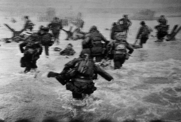 "Magnum Photos: Robert Capa © International Center of Photography. France. Normandy. June 6th, 1944. Landing of the American troops on Omaha Beach. One of Capa's ""Magnificent Eleven"" pictures of the landing."