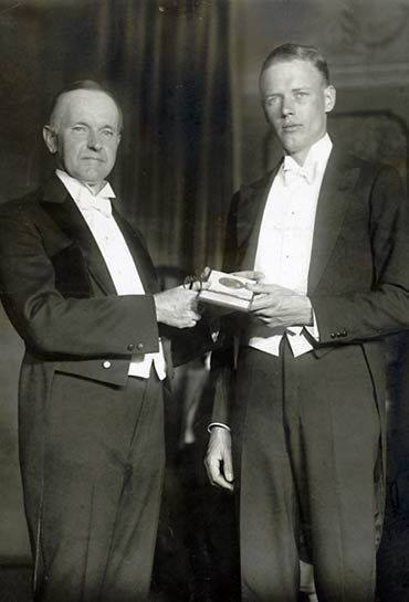 Calvin Coolidge presents Charles Lindbergh the Congressional Medal of Honor for his first trans-Atlantic flight.