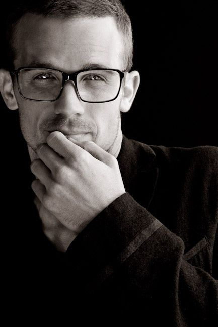 Cam Gigandet: Unknown Photographer but I just can't get over the contrast and values of black and white photos. Not crazy about the glasses. He doesn't wear them normally. It's got to be that crap hipster phase.