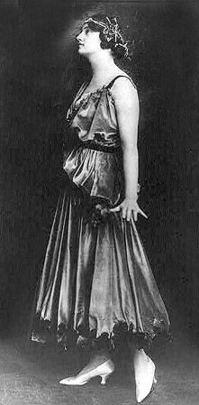 Jeanne Paquin (1869–1936) was a leading French fashion designer, known for her resolutely modern and innovative designs.  She was also the first woman designer to open her own fashion house in Paris
