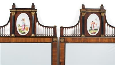 Exquisite and rare pair of Viennese Empire wall mirrors, Circa 1810, veneered mostly in yew, with contouring in stained pearwood, also with filigree fretwork, porcelain medallions and columns at the angles. 110 x 53 cm. Wien, Dorotheum, 22.04.15, no. 551.