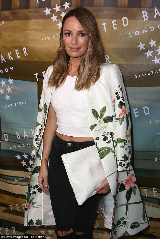 Flower power: Catt Sadler sported a stunning floral print jacket which she rested over her...