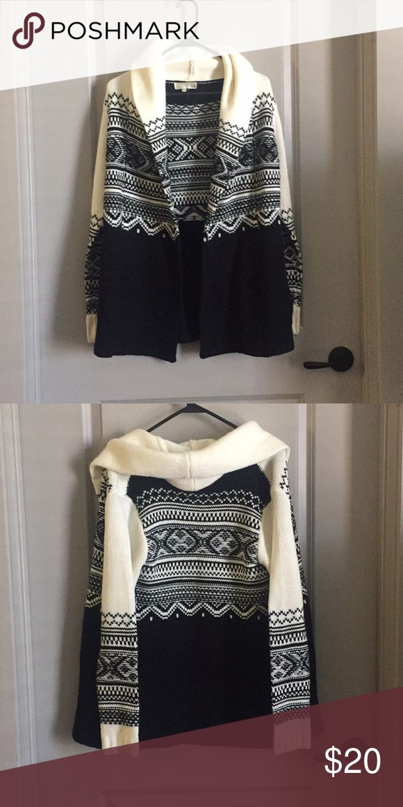 Black and white cardigan Black and white cardigan with hood and pockets. Very warm Sweaters Cardigans