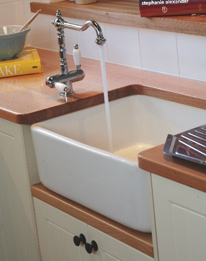 Cheaper Sink - more what I want.  Site has free Delivery in Australia.  http://www.restorationonline.com.au/kitchen-sinks-and-laundry-tubs/fireclay-sinks-sink/butler-sink-fireclay-250mm-deep-without-overflow $489