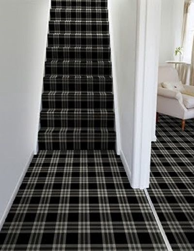 A White Hallway Staircase With Bold Black Tartan Carpeting