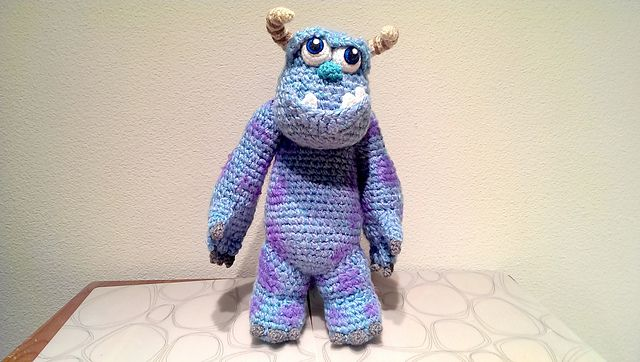 """Inspired from Monster's Inc Sully. The doll is approximately 15"""" Tall and is made from acrylic yarn, felt, fabric paint, and polyfil fibers. He has pipe cleaners in his horn so be careful if you want this as a gift for young children. He's the perfect companion for a love one who loves Monster's Inc. His head can move around and his arms are flexible enough to move around as you want."""