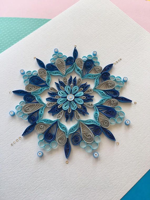 This is a beautiful quilled mandala designed and created by me. It can be framed and hung on a wall which would make a very beautiful decoration. It would be perfect for a childs bedroom or anywhere in your home. Swarovski crystals are used to embellish this piece. -Dimensions