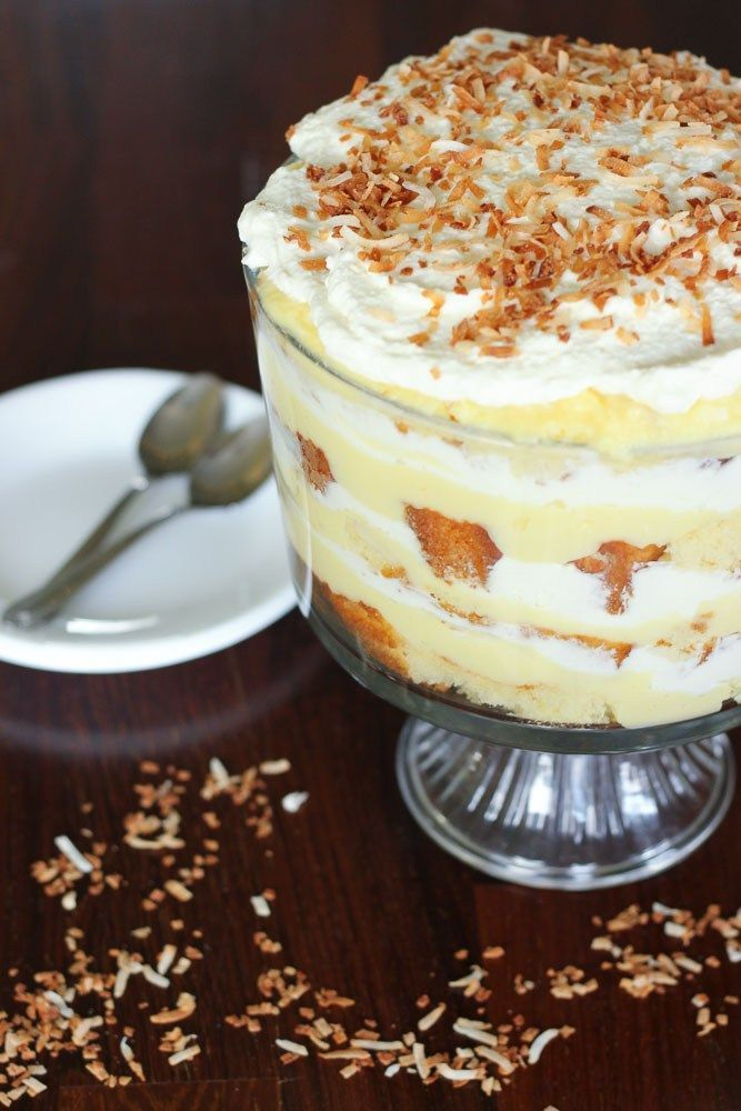 This Easy Coconut Cream Trifle is so much easier than pie, and just as  delicious.  Enjoy this rich, luscious coconut cream trifle as a  Thanksgiving dessert this weekend, or at a gathering any time of year!  You can even make all the easy parts ahead of time and assemble the  trifle later! #makeaheaddesserts #bestthanksgivingrecipes #thanksgivingdessert #coconutcreampie