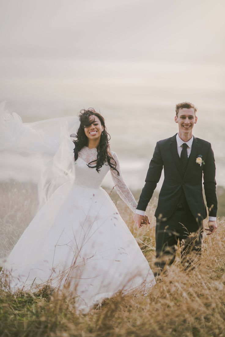 Rebecca's dream wedding. A beautiful summer setting, with romantic New Zealand feel. Rebecca wore a true stunner of a bridal gown with a very full skirt! The couture gown was all in beaded lace featuring a very low back and long sleeves. #real #brides #wedding #dream #dress