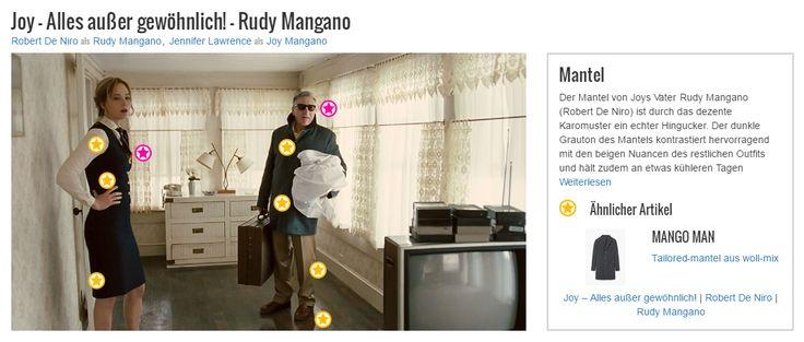 Der Mantel von Joys Vater Rudy Mangano (Robert De Niro) ist durch das dezente Karomuster ein echter Hingucker. Der dunkle Grauton des Mantels kontrastiert hervorragend mit den beigen Nuancen des restlichen Outfits und hält zudem an etwas kühleren Tagen wunderbar warm. Außerdem verdeutlicht der aufgestellte Kragen des Mantels die stets erwähnenswerte Lässigkeit von Vater Rudy.