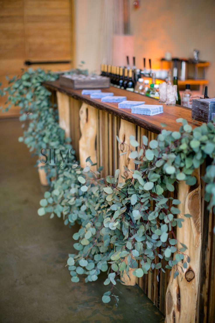 A garland of silver dollar eucalyptus will hang under the pavilion bar. www.stemfloral.com www.nicholsphotographers.com www.barrmansion.com