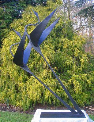 garden sculpture of flying birds