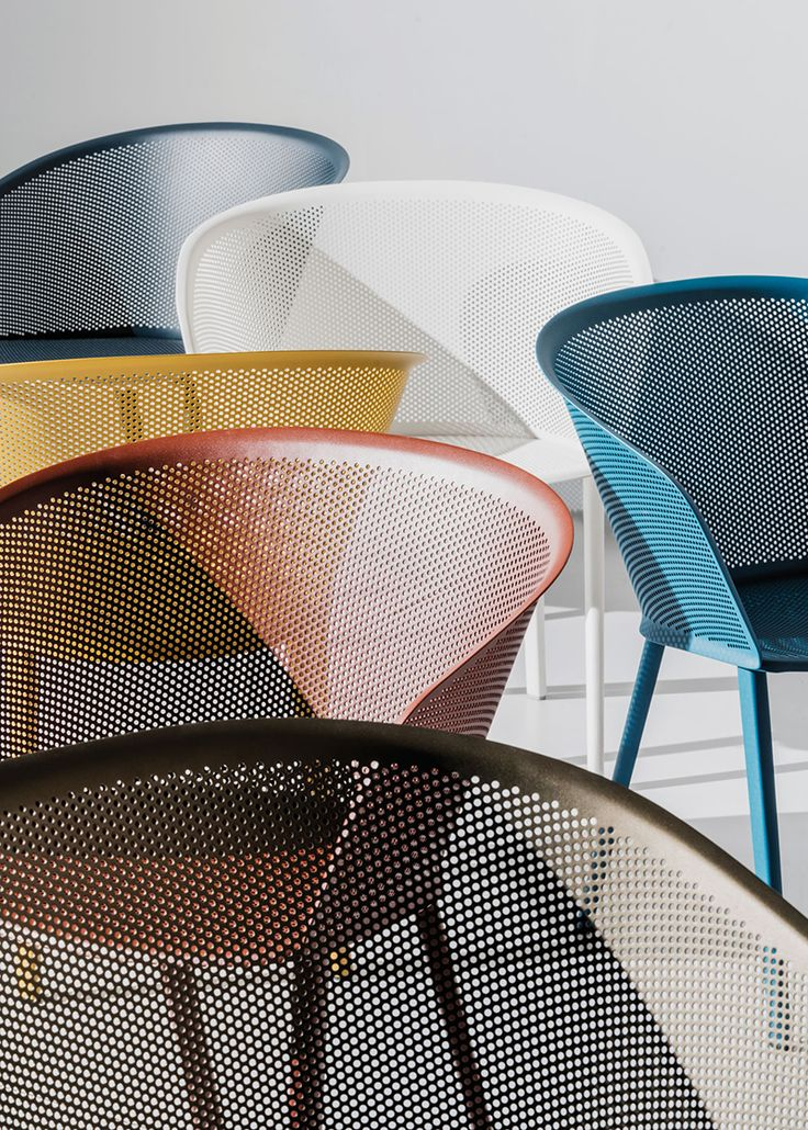 A calyx shaped metal shell is inhabited by carefully organized holes made by the technique of punching metal sheets. This allows to create delicate shapes that recall textile sensations and are robust enough to stand the test of time.