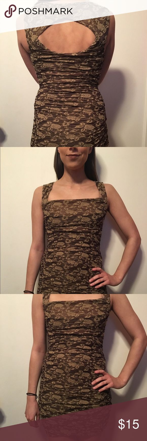 Gold and bronze floral print free people dress Free people gold and bronze floral tight fitting dress. Semi formal. Good for going out for a night on the town. Worn a couple times. In good condition. Free People Dresses Mini