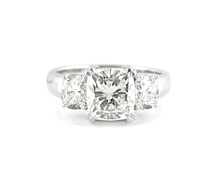 An 18ct White Gold Trilogy Ring with Cushion Cut Diamonds