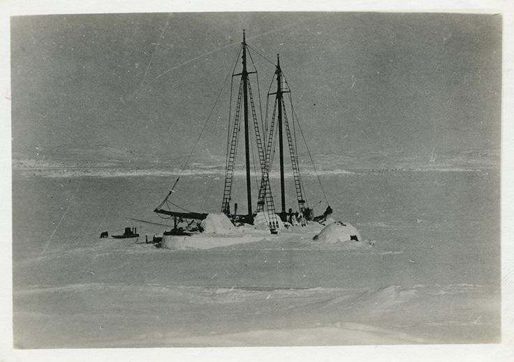 """The schooner """"Bowdoin"""" iced in at Idjirituq (Schooner Bay) during the winter of 1921–22. The crew worked with local Inuit—among them Pitseolak's father, Ottochie—to construct snow domes over the boat's hatches; the domes provided wind protection while allowing air to circulate into the vessel."""