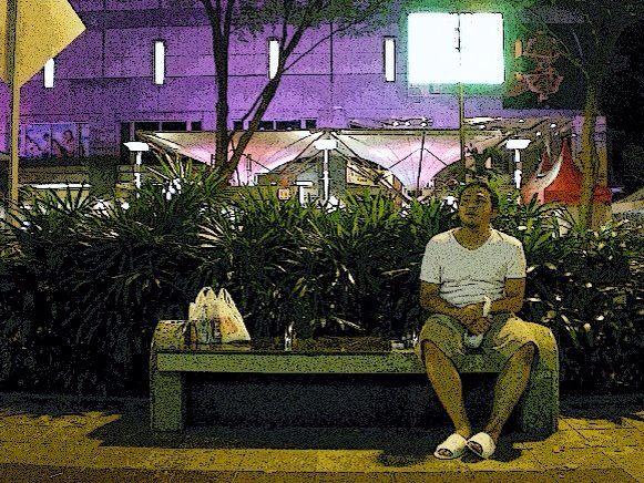 waiting on the sidewalk Ochard Road , Singapore .