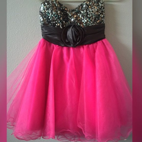 """Hot pink strapless homecoming dress Hot pink strapless homecoming dress with sequined black top. Only worn once. Fits like a small even though size is a """"3"""" Dresses Prom"""