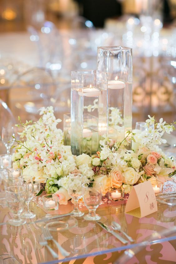 White flower floating candle wedding reception centerpiece