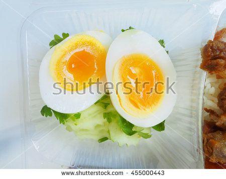 boiled egg. medium-boiled egg. half-boiled egg. boiled egg on white dish. cooked egg.