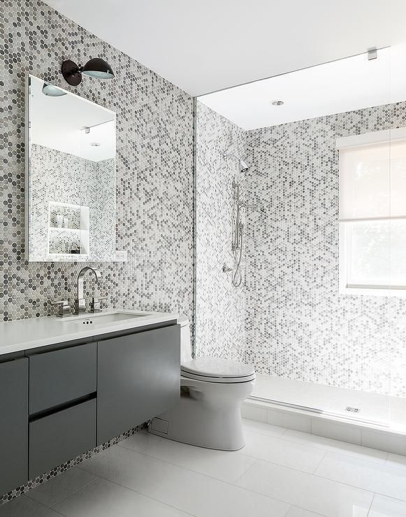 Gray Kids Bathroom Features A Gray Floating Vanity Under A