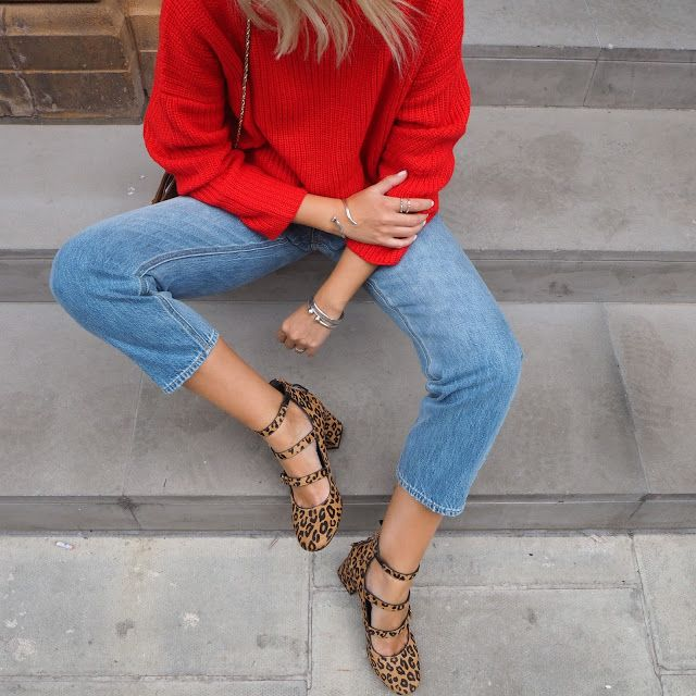 MOOD: Alex from The Frugality styles a bright red jumper with frayed denim and strappy leopard print flats.