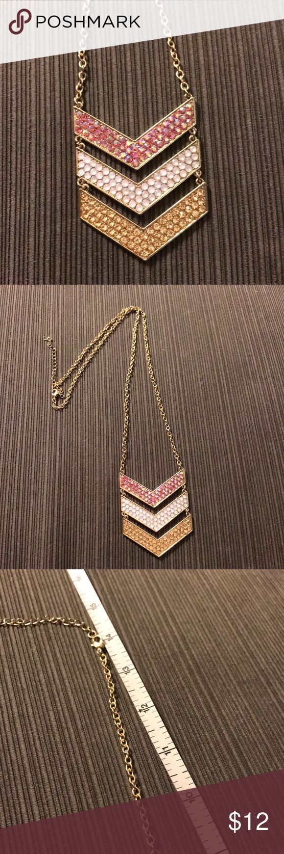 Multicolored chevron designed long chain necklace Very beautiful chevron designed necklace. 3 logos range in colors from fuchsia iridescent, a rose gold, and a white pearl color. Has a very long chain attached, there are 2 pictures showing the length of the chain from the emblem to the end, & at the end there's a small adjustable chain for more fitted. Outer detail is gold. If you're handy u can use pliers to shorten the chain.  This necklace is included in SALE of 3 for $20 and I'm open to…