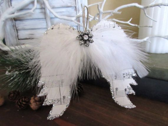 Stunning vintage sheet music angel wings.  There is a hanger on the back .  Wings measure approximately 5 x 4,5 This would be great for Christmas