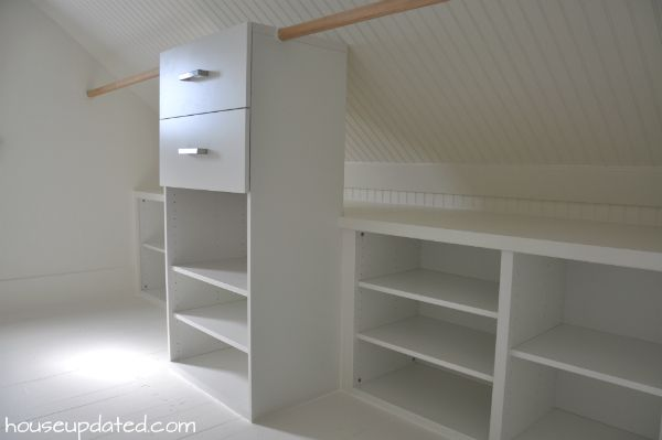 Organization and Storage Solutions for Closets with Sloped Ceilings or Low Ceilings: Build in two layers of storage with shelving for off-season storage in the back and additional shelving, drawers, and hanging storage in the front! Keep it bright with white paint and interesting with beadboard.