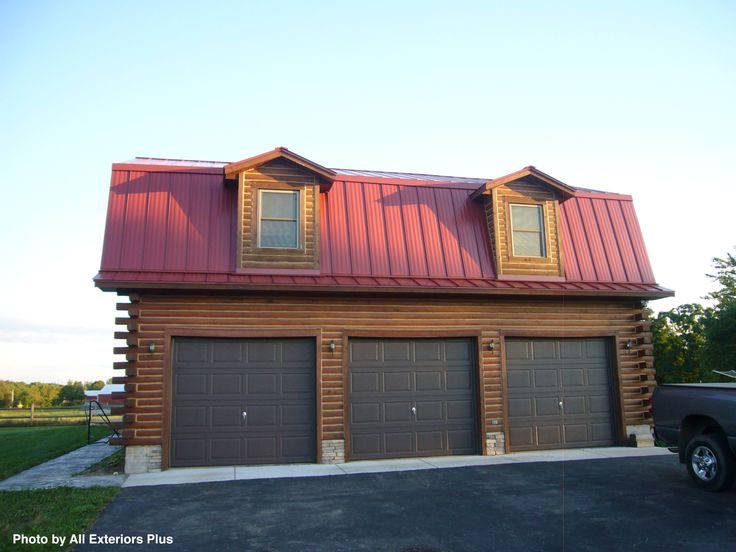 Triple Garage With Contrasting Colors Throughout The Red