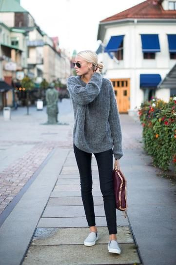 winter outfit idea - oversized gray fuzzy sweater worn with skinny jeans and slip on shoes: