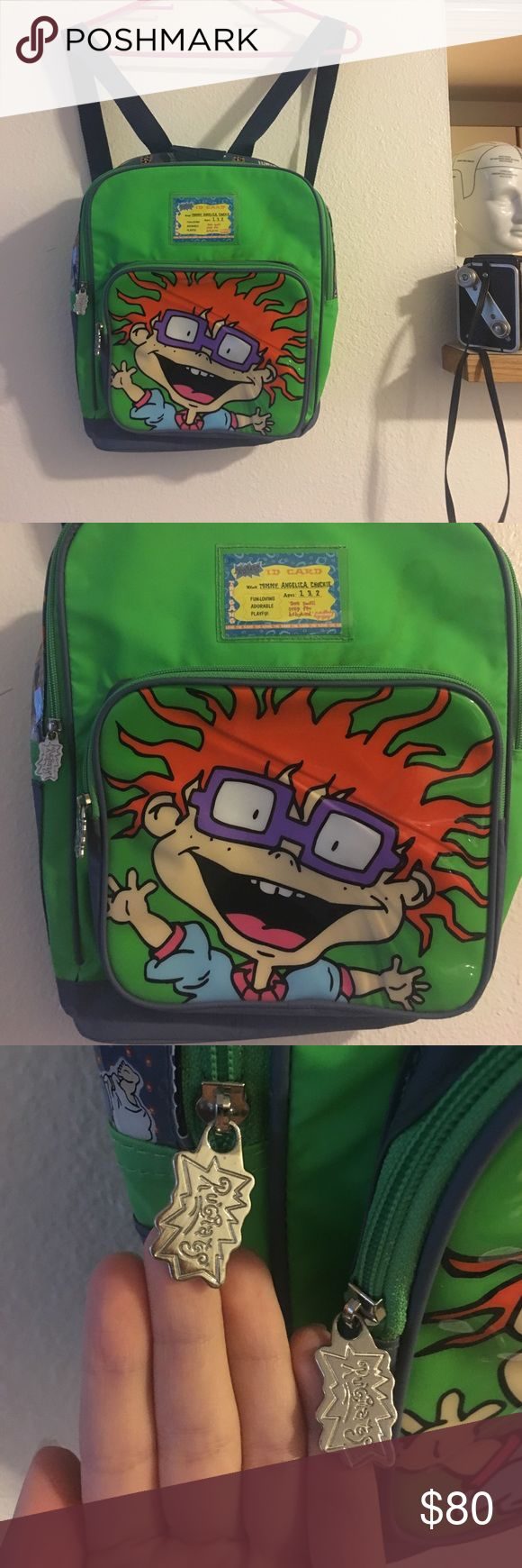 "90s nickelodeon rugrats chucky backpack RARE This backpack is SO COOL! It's one of my favorite finds. It is in Great condition. Almost appears unused. The zippers are in perfect working condition, the backpack is extremely clean inside but does have a faint stain on the front and it still has its original ""ID card) and the zippers has the rugrats logo on them. A picture of chucky on the front and a cool rugrats pattern/print on the top. It's a great vintage or collectors piece!Let me know if…"