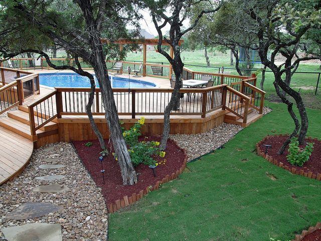 Custom deck and landscaping - Bexar County by abovegroundpoolcompany, via Flickr
