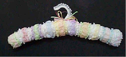 Knit in Lace FREE padded coat hanger pattern.