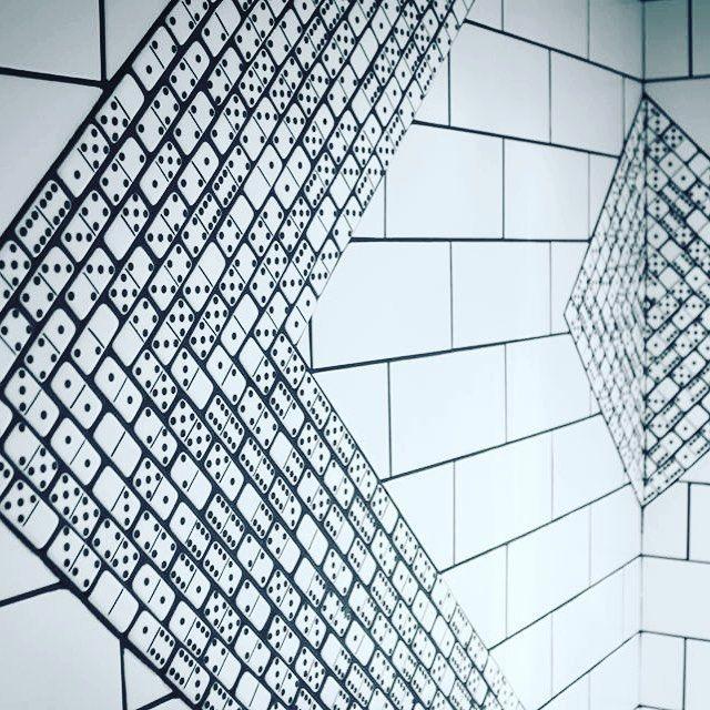 We do custom tile designs. Dominos in a @nandosusa restaurant bathroom! #bespoke #dominos #hospitalitydesign #design #bathroom #moderninteriordesign #restaurantdesign #restaurant #blackandwhite #tiles #modwalls