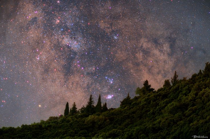 A Voyage into Cosmos, Liapades, Corfu - A Voyage into Cosmos, Liapades, Corfu  Night landscape above the forest of Liapades traditional village in the western Corfu. With our the Core of our Galaxy, Milkyway, into the cypress.  Canon eos 6D, EF 85 1.2 LII, 85mm, f/2, iso800, 7X8sec, DSS, PS, on a tripod - no tracking