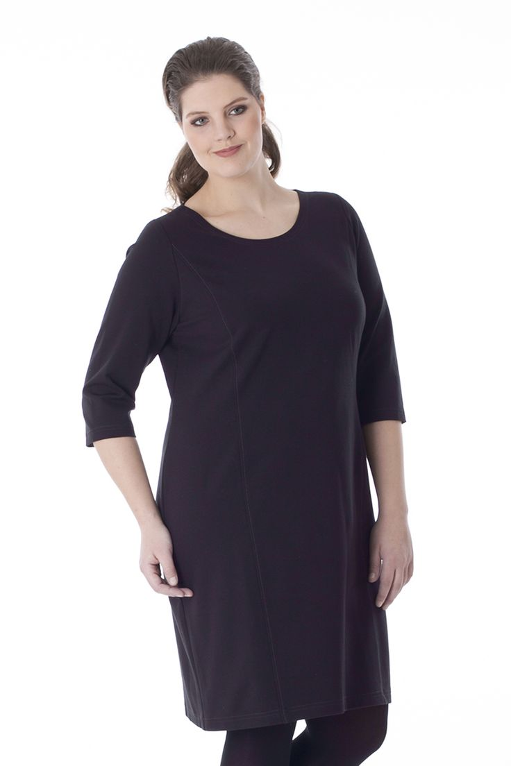 Exelle   Comfortable jersey dress made from 'punta di Roma' fabric in viscose/nylon. The straight cut dress is slightly tailored. Sewed with a contrast stitching. The dress has 3/4 sleeves, a round neckline and a metal-look plastic zipper in the back.