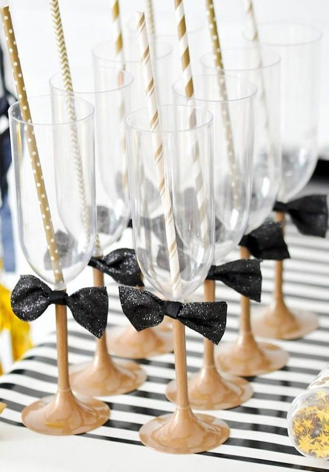 Add bow ties to your champagne glasses to serve your prosecco in style for your Golden Globes viewing party.