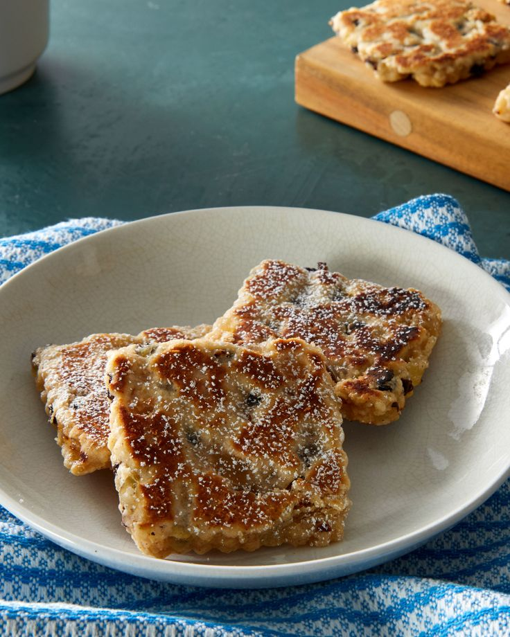 Welsh Cakes   Martha Stewart - A cross between a cookie, scone, and pancake, these intriguing treats are cooked on a griddle, not baked (despite its other name, Welsh bakestones). Martha's version is spiced with cinnamon and nutmeg and studded with dried currants and candied lemon peel. #cookierecipe #welshrecipe #teacookie