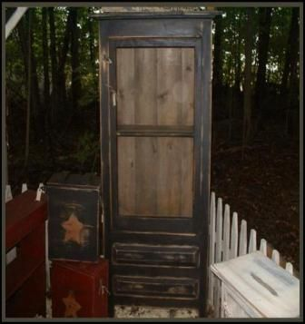 Screen Door Cabinet With Drawers will be a great addition to your country rustic or primitive decor.  This handcrafted screen door cabinet with drawers comes with a screen door and shelf on the top and two drawers on the bottom for extra storage.