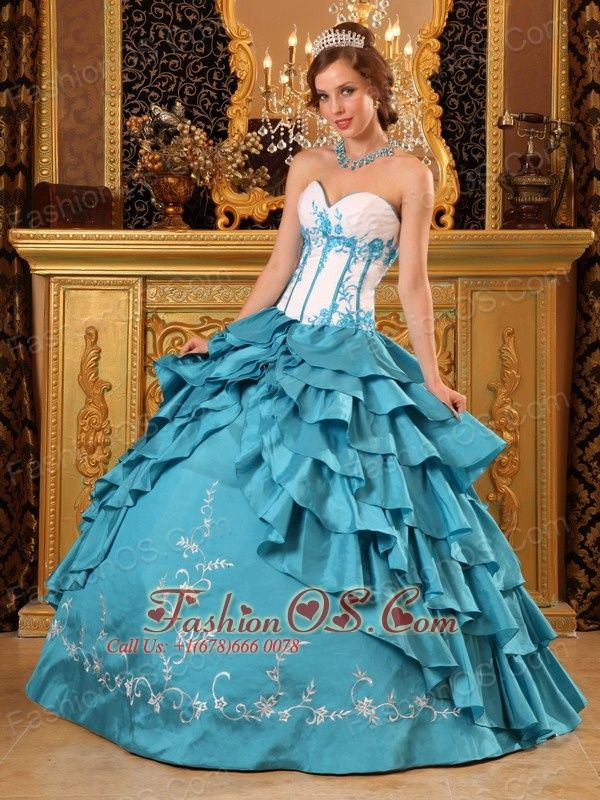 Popular Teal Quinceanera Dress Sweetheart Ruffles And Embroidery Taffeta Ball Gown  http://www.fashionos.com  Make an entrance in this quiceanera romantic ball gown! The embroidery applique bodice is comprised of ruched bust and some boning details , which creating the illusion of a fuller bust line. The romantice puffy skirt with floral embroidery features several winding ruffled tiers overlay , which adds to a lot of fullness .