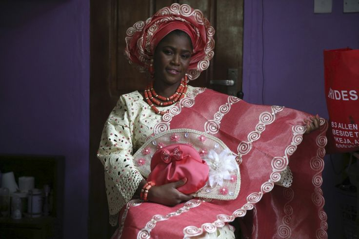 Nigerian brides stand out with their bright lacy blouses and patterned kaftans, which are often made from Indian fabrics. Coral beads and an elaborate hat complete the look.