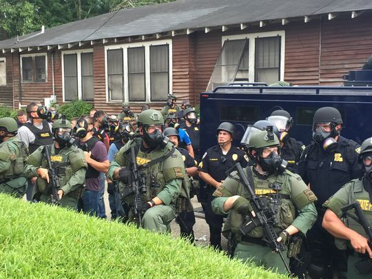 Louisiana State Police and Baton Rouge police in riot