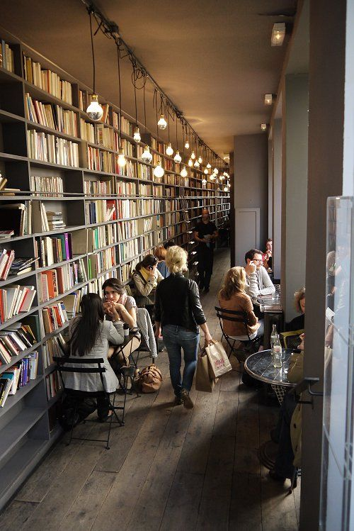 """Great use of a narrow space for books- love the lighting too.   the shop is called """"Merci"""" in Paris, photo thanks to @Desiree  of Vosages Paris"""