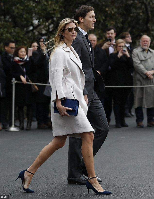 Ivanka Trump wears her own label's shoes and purse as she walks alongside  her husband,