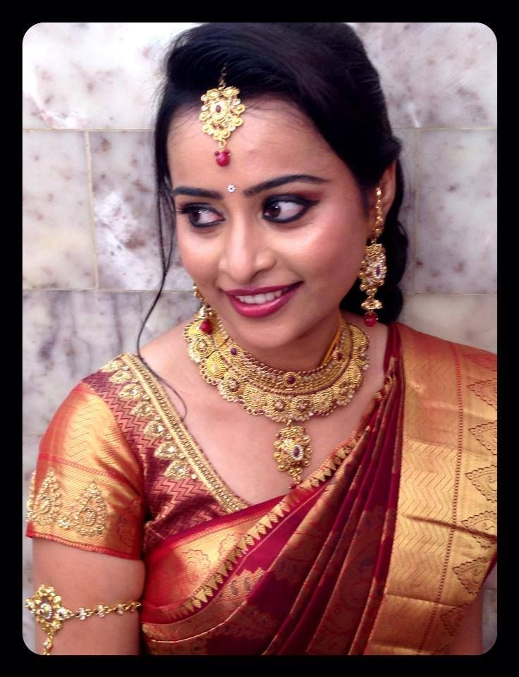 traditional south indian bride wearing bridal saree and jewellery. indian weddings and bride