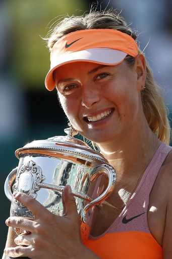 Russia's Maria Sharapova holds the trophy after winning the final of the French Open tennis tournament against Romania's Simona Halep (AP)
