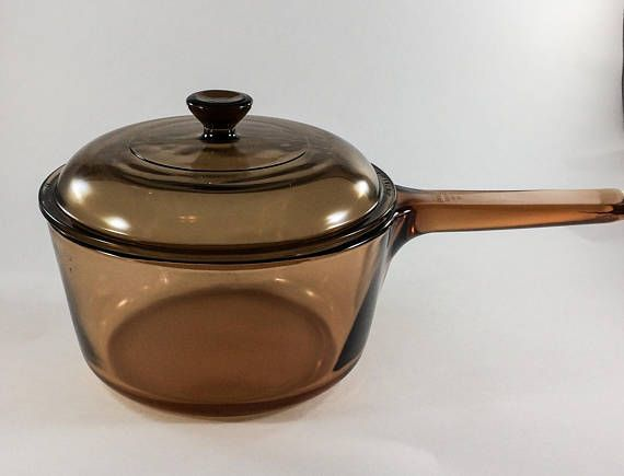 Amber 1.5 Liter Sauce Pan by Corning Visions  Pan is 7 1/4 inches wide and 3 3/4 inches deep.  Pyrex lid with numbers V-1.5-c B 32  No chips or cracks.  Items was produced starting in 1983.  Message for best offer.