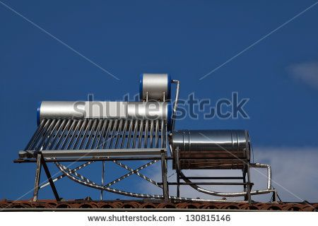 Solar water heating system on a house roof