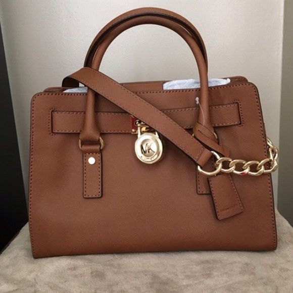 ISO Michael Kors Hamilton East West Handbag In the Luggage color or Navy & White Striped. Really want it...looking for every good condition! Please help me find this (Pictures are not mine...just using to show what I'm looking for and the condition...from Poshmark) MICHAEL Michael Kors Bags
